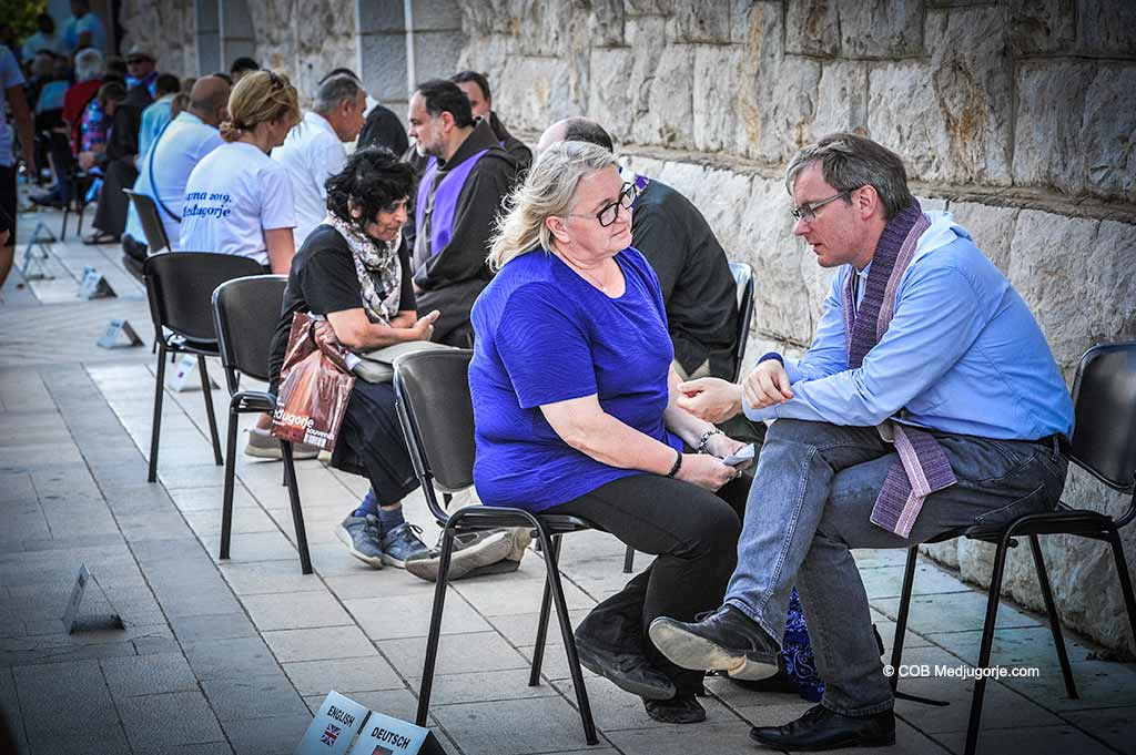 Pilgrims go to confession in Medjugorje
